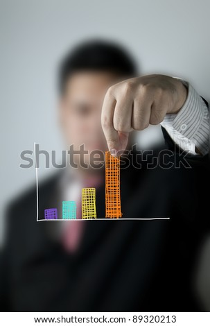 Businessman pulling up a bar from a graph - stock photo