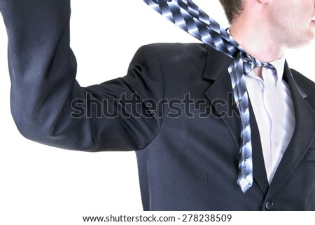 Businessman Pulls tie Choking Himself. Isolated on White Background - stock photo