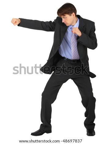 Businessman punching isolated on a white background - stock photo