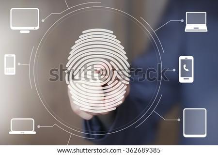 Businessman push button fingerprint print computer - stock photo