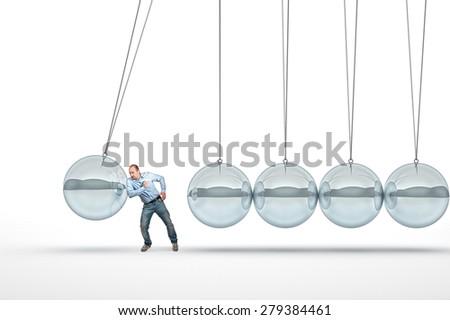 businessman push 3d abstract newton cradle - stock photo