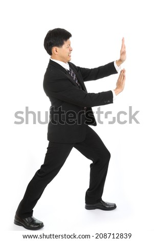 Businessman push something away from his business - stock photo