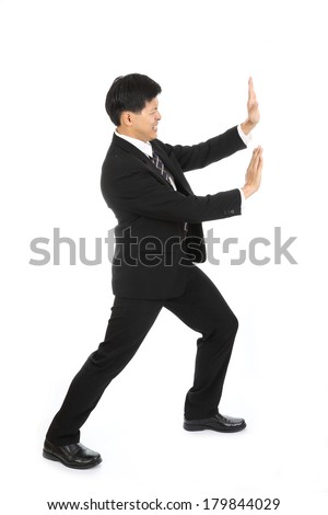Businessman push something away from his business with white background