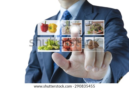 Businessman push virtual button screen select healthy foods menu,isolated on white background - stock photo