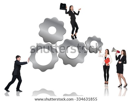 Businessman pushes metal gears , women stands beside, isolated on the white background