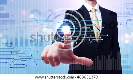 Businessman pushing a button on a digital touch screen