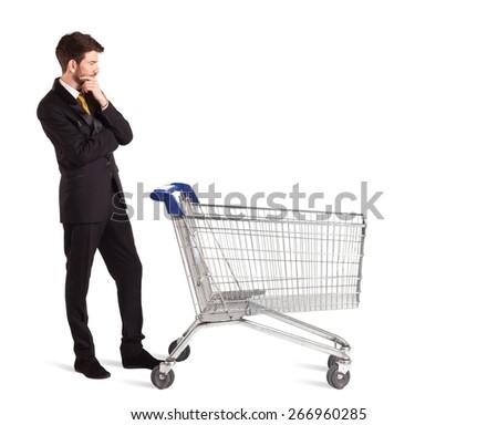 Businessman pushing a shopping cart on isolated background  - stock photo