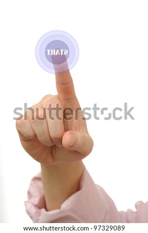 Businessman pushing a start button on touch screen - stock photo