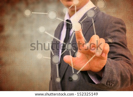 businessman pushing a touch screen interface in the old paper - stock photo