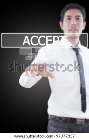 Businessman pushing Accept word on a touch screen interface.