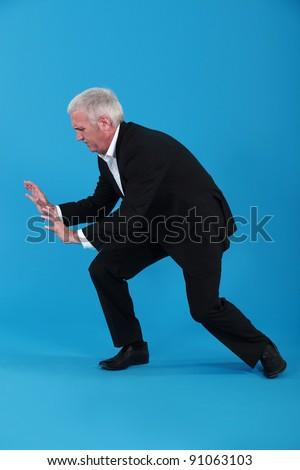 Businessman pushing against empty copyspace - stock photo