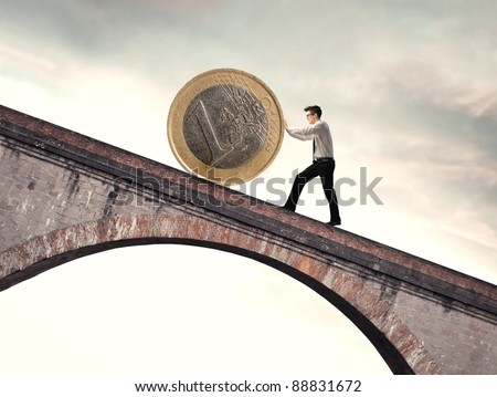 Businessman pushing an euro coin uphill - stock photo