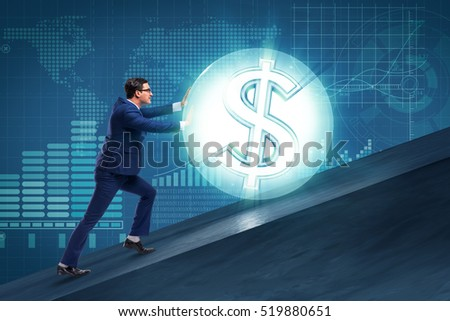 Businessman pushing away dollar ball