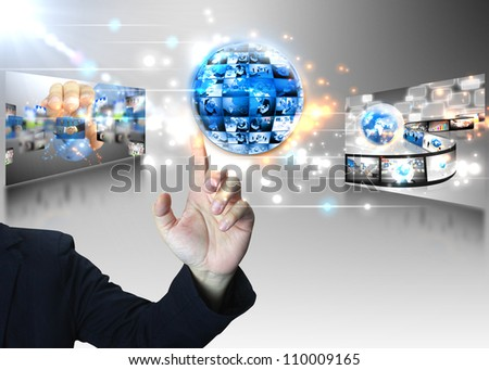 Businessman pushing business world - stock photo