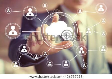 Businessman pushing button cloud protection antivirus security shield - stock photo