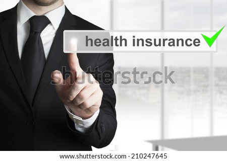 businessman pushing button health insurance - stock photo