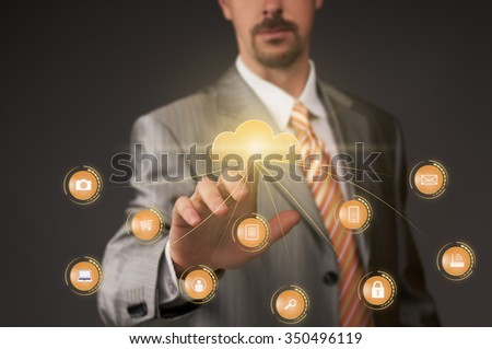 Businessman pushing cloud button on multimedia touch screen