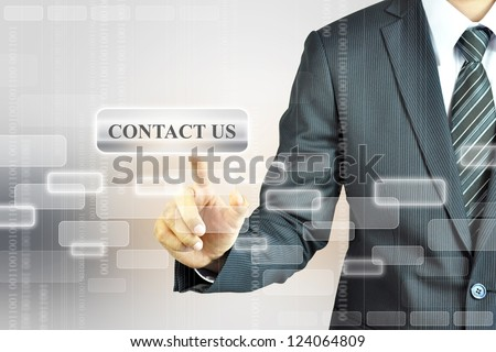 Businessman pushing CONTACT US sign - stock photo