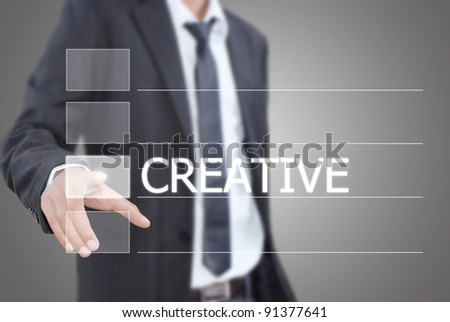 Businessman pushing Creative word on a touch screen interface. - stock photo