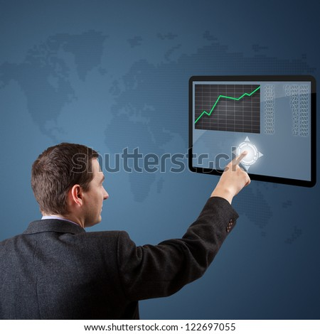 Businessman pushing digital button on tablet screen - stock photo