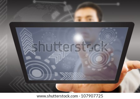 Businessman pushing digital button on tablet screen interface.