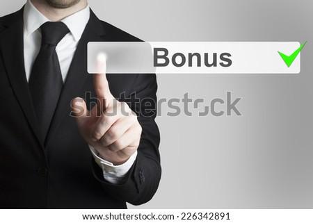 businessman pushing flat button bonus green checked - stock photo
