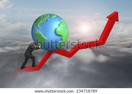 businessman pushing globe upward at starting point of red trend line with sunlight cloudscape background - stock photo
