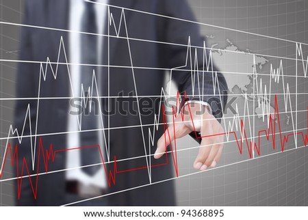 Businessman pushing graph for trade stock market on the whiteboard. - stock photo