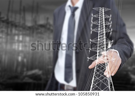 Businessman pushing High voltage power pole line.