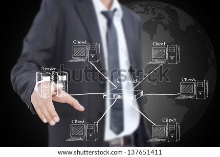 Businessman pushing LAN Network diagram on the whiteboard. - stock photo