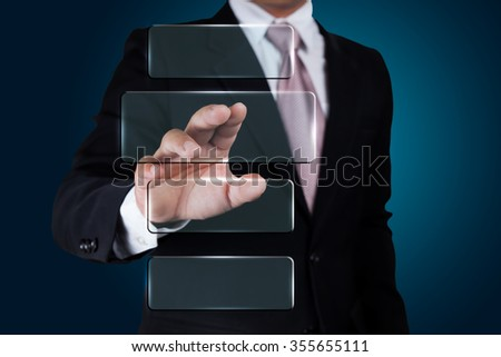 Businessman pushing on a touch screen interface. - stock photo