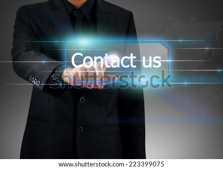 businessman pushing on contact us button.  - stock photo