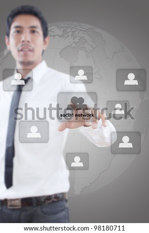 Businessman pushing people social network. - stock photo