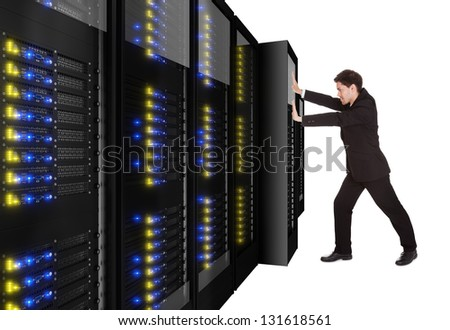 Businessman pushing server rack in place. Isolated on white - stock photo