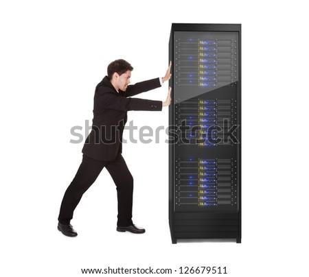 Businessman pushing server rack. Isolated on white - stock photo