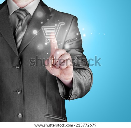 Businessman pushing shopping cart - stock photo