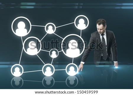 businessman pushing social media interface on table - stock photo
