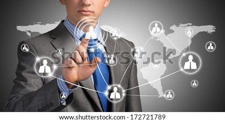 businessman pushing social network on the symbols on the touch screen - stock photo
