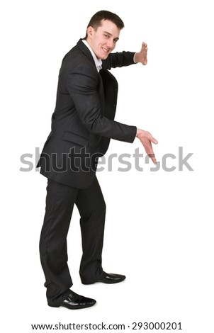 Businessman pushing something