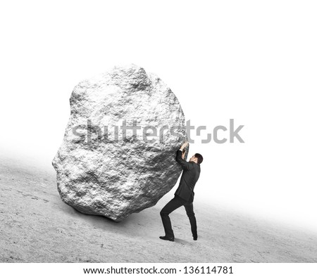 businessman pushing stone up hill - stock photo