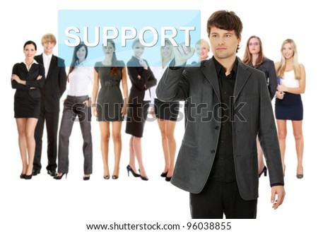 Businessman pushing SUPPORT on a touch screen interface. Business team at background - stock photo