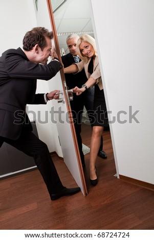 Businessman pushing the door - stock photo