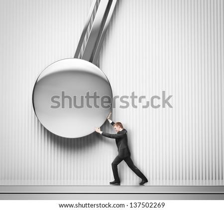 businessman pushing the pendulum - stock photo