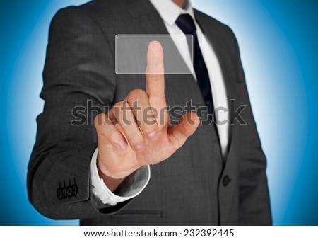 Businessman pushing virtual button - stock photo