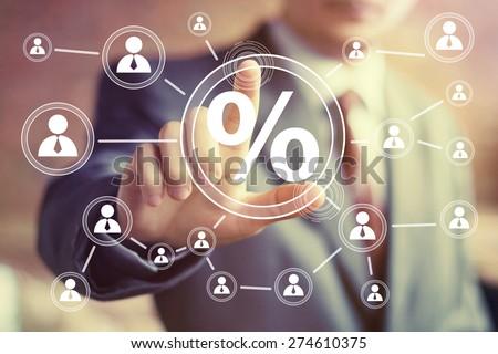 Businessman pushing virtual button web percent sign. - stock photo