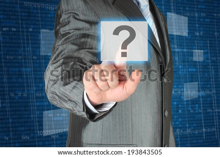 Businessman pushing virtual question button on digital background - stock photo