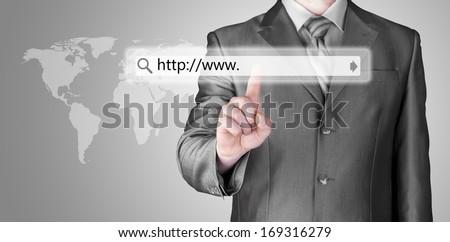 Businessman pushing virtual search bar - stock photo