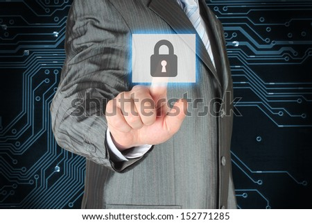 Businessman pushing virtual security button on circuit background  - stock photo