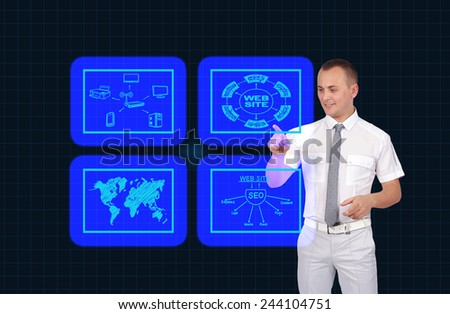 businessman pushing virtual touch screen with icons - stock photo