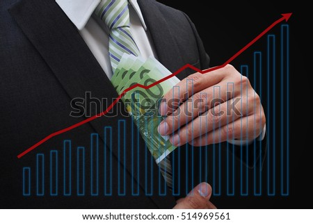 Businessman putting euro banknotes in suit pocket on a graph indicating growth